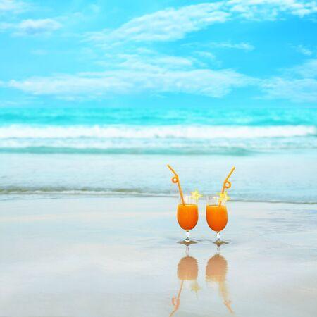 Two glasses of orange juice on tropical beach Stock Photo - 5118020