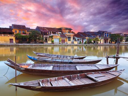 rushes: View on the old town of Hoi An from the river. Boats in the foreground. Stock Photo
