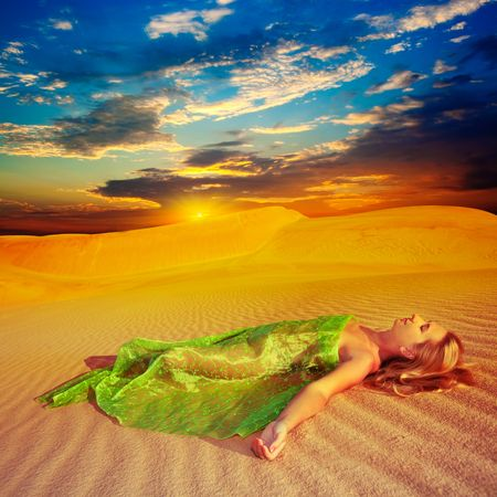 Beautiful woman sleeping in the middle of desert photo