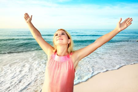 woman hands up: Happy woman with hands up at sunrise time Stock Photo