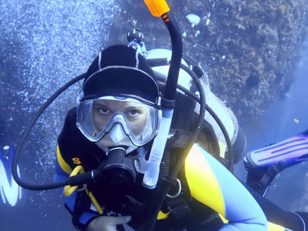 Scuba diver underwater looking at camera.  photo