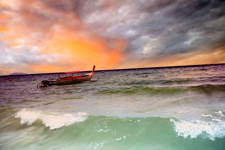 Traditional Thai longtail boat in the ocean photo