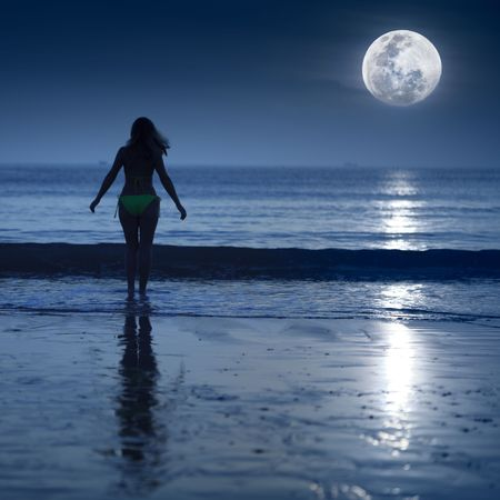 tonight: Woman is going to swimming under moonlight Stock Photo