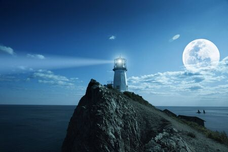 Lighthouse at nighttime. Japanese sea. photo