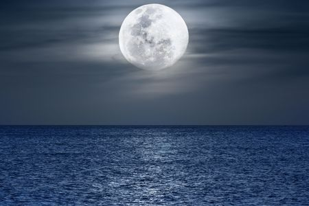 pacific ocean: Water surface under moonlight at nighttime. Pacific Ocean