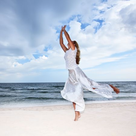 carribean: Young woman is dancing on the beach Stock Photo