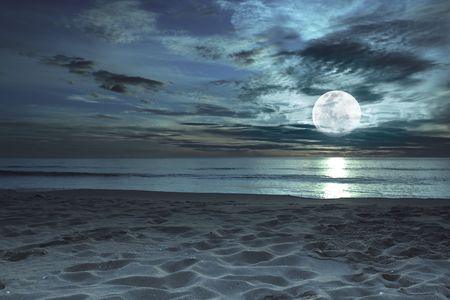 moon night: Beautiful beach at twilight time with moon in the sky Stock Photo