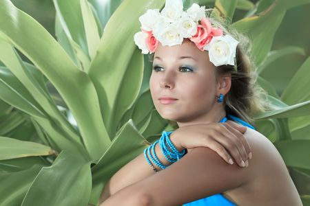 Portrait of a young woman with flowers photo