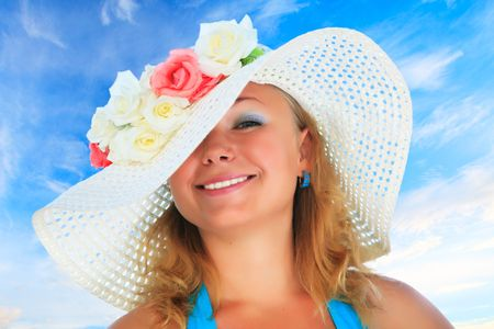 Young funny woman in hat with flowers photo