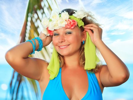 Young happy woman with wreath on her head photo