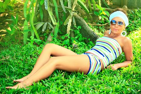 Young beautiful woman lies on the grass photo