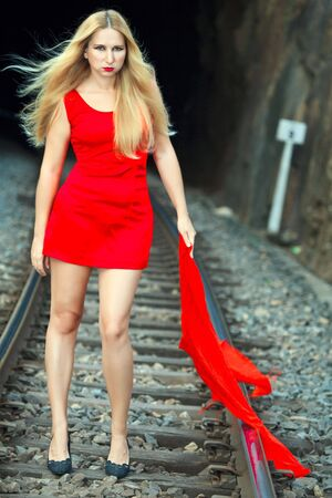 Young beautiful woman is posing on train track Stock Photo - 6752139