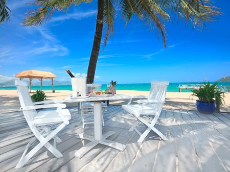 Dining table on the beach close to the ocean Stock Photo - 6918623