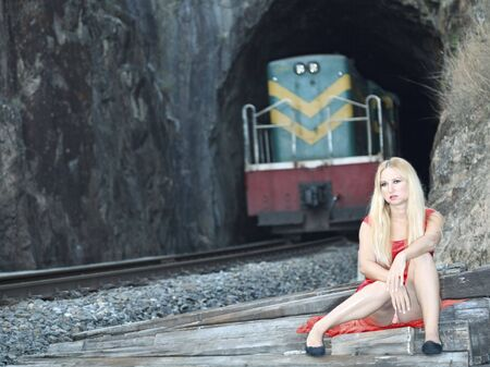 Young beautiful woman is sitting near railway tunnel Stock Photo - 6881893