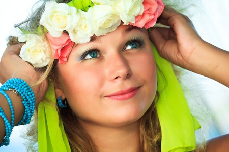 Close-up portrait of a young beautiful woman in wreath photo