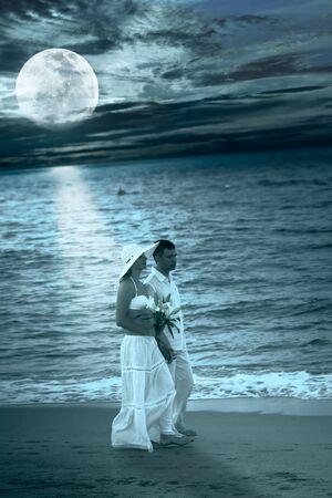 Romantic couple walking near ocean at night time Stock Photo - 6998934