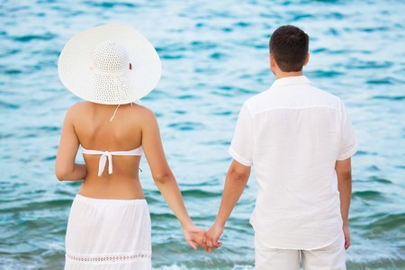 Rear view of romantic couple near the ocean photo