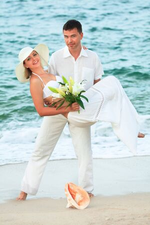 man carrying woman on the tropical beach Stock Photo - 7127008