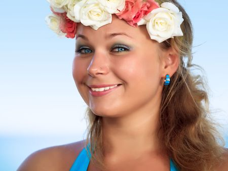 Portrait of a smiling womanl with flowers photo