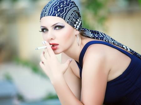 Young beautiful smoking woman.  photo