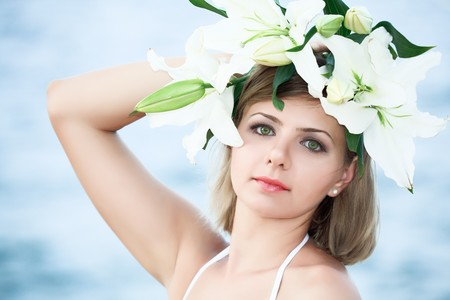 Portrait of a young beautiful woman in wreath photo