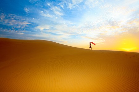 gobi desert: Beautiful woman with red showl in desert