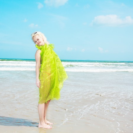 beach wrap: Young woman in green wrap at the  beach Stock Photo