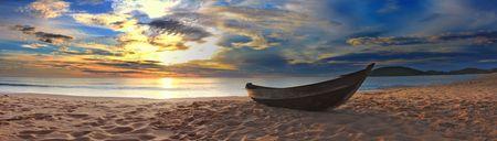 fisherman on boat: Old fisherman boat at the beach. Panorama Stock Photo