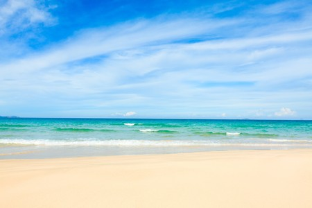 unspoilt: Beautiful white sand tropical beach at day time Stock Photo