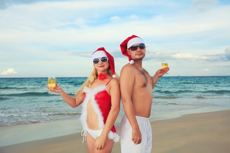 Couple celebrates Christmas at the tropical beach photo