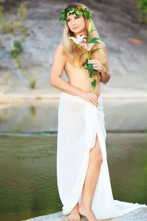 Beautiful woman as a forest nymph on the river Stock Photo - 7539006