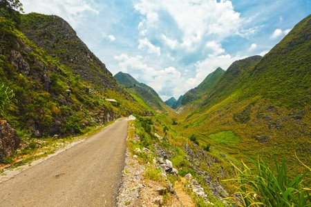 earth road: Mountain road in beautiful valley. Ha giang. Vietnam Stock Photo