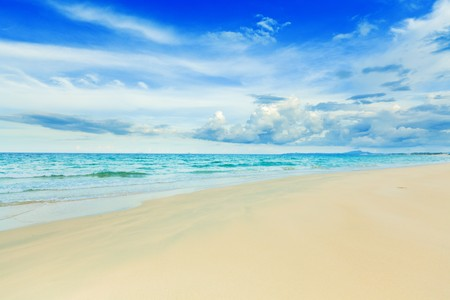 Beautiful white sand tropical beach at day time Stock Photo