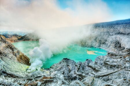Crater of volcano Ijen at sunrise time. Java. Indonesia.  photo