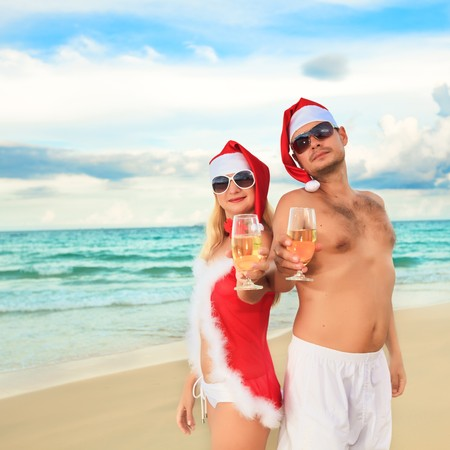 santa lingerie: Couple celebrates Christmas at the tropical beach Stock Photo