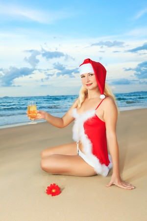 Sexy Santas helper at the tropical beach photo