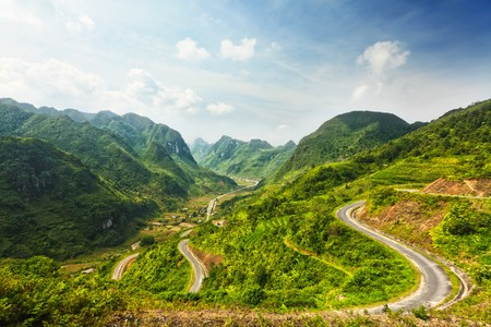 Mountain road in beautiful valley. Ha Giang province. Vietnam Stock Photo - 7598384