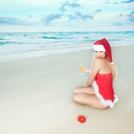 Sexy Santa's helper at the tropical beach Stock Photo - 7598169