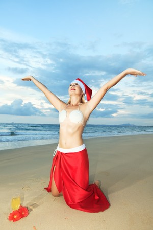 Miss Santa celebrates Christmas at the tropical beach photo