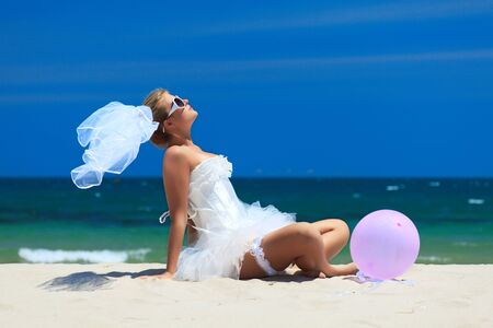 Beautiful young  bride on the tropical beach Stock Photo - 7843111