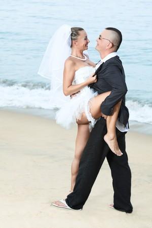 Wedding dance on the tropical beach photo