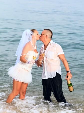 Wedding kiss on the tropical beach photo