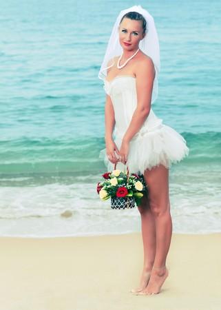 Bride on the tropical beach photo