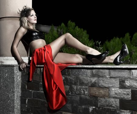 Low key image of fashion model outdoor photo