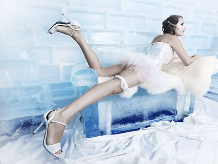 Woman as a snow queen in ice room photo