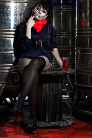 satanic: Woman as a vampire. Halloween face art Stock Photo