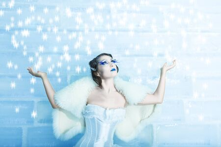 Christmas woman as a snow queen in ice room photo