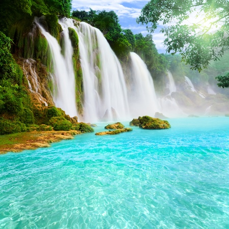 background waterfalls: Detian or Ban Gioc waterfall along Vietnamese and Chinese board. Stock Photo