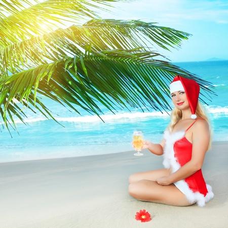 Sexy Santas helper at the tropical beach photo