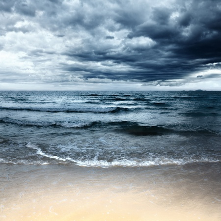Sandy beach at stormy day. Dramatic sky photo